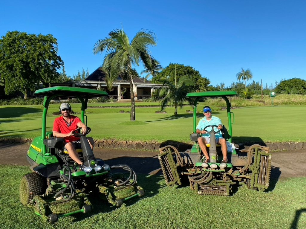 Homeowners on golf lawnmowers